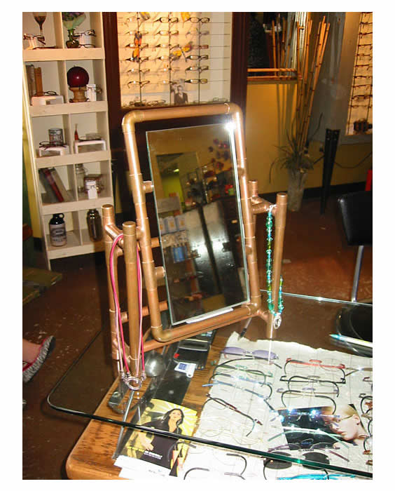 Image of Copper Mirror Used for Eyewear Fitting