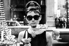 Audrey Hepburn wearing Ray-Ban Wayfarers as Holly Golightly in Breakfast at Tiffany's
