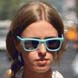 Image of Nicky Hilton in Baby Blue Ray-Ban Wayfarer Sunglasses