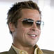 Image of Brad Pitt in Oliver Peoples Strummer Sunglasses
