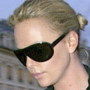 Image of Charlize Theron in Miu Miu 18GS Sunglasses