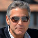 Image of George Clooney in Prada 50LS Sunglasses